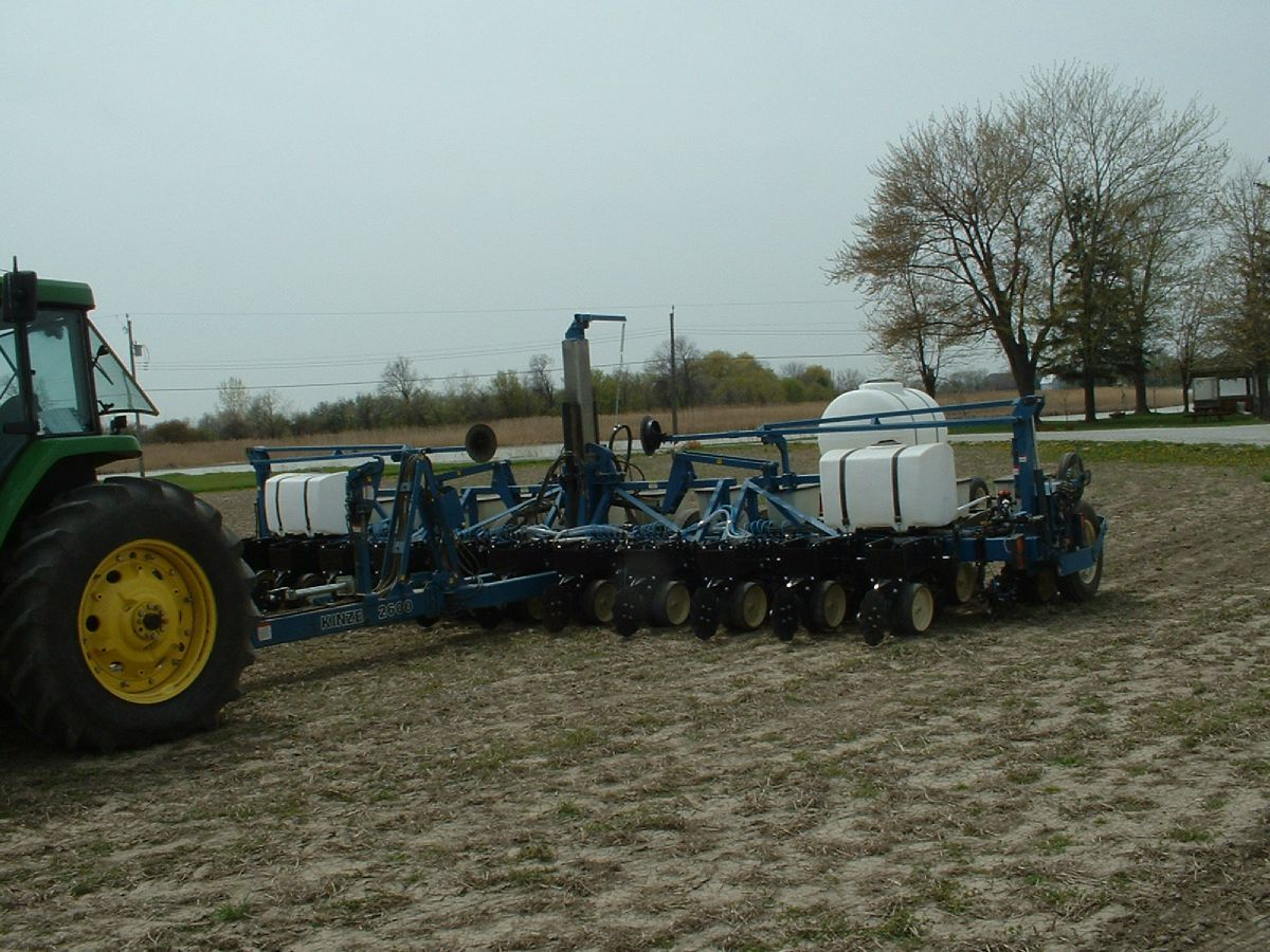 Fertilizing machine in farmers field