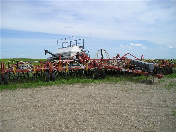 Farm equipment in field with sky