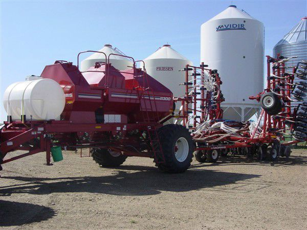 Farm equipment with holding tanks