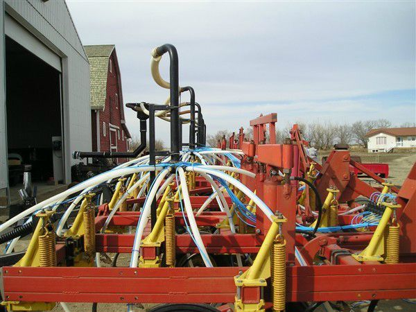 Farm equipment with building